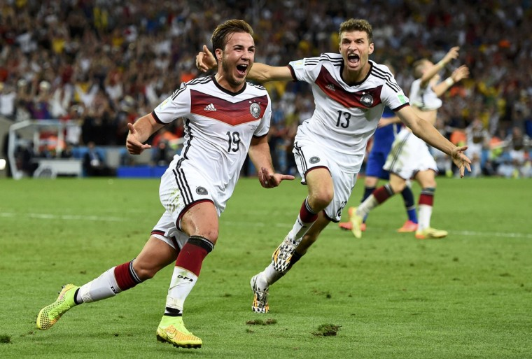 Germany's Mario Goetze (L) celebrates near teammate Thomas Mueller after scoring a goal during extra time in their 2014 World Cup final against Argentina at the Maracana stadium in Rio de Janeiro July 13, 2014. (Dylan Martinez/Reuters)