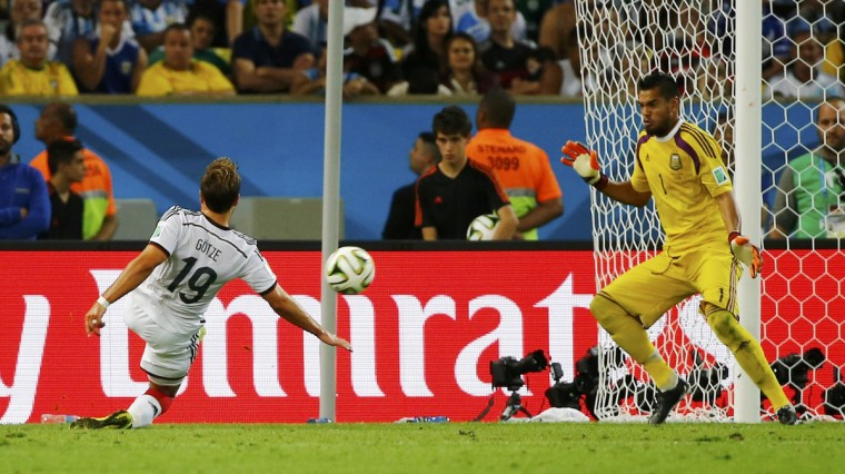 Germany's Mario Goetze (L) shoots to score against Argentina's Sergio Romero during extra time in their 2014 World Cup final at the Maracana stadium in Rio de Janeiro July 13, 2014. (Damir Sagolj/Reuters)