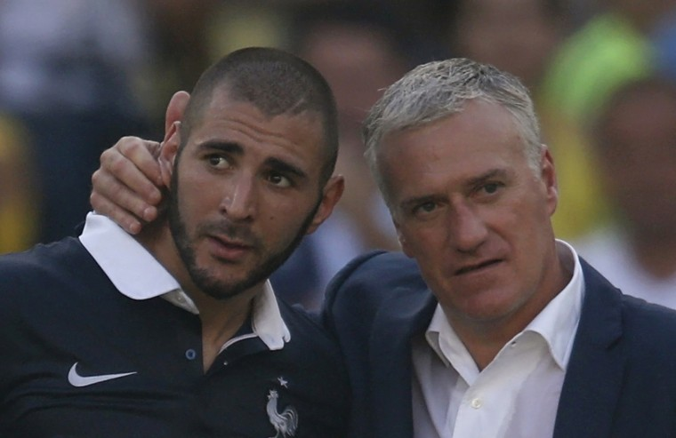 France coach Didier Deschamps (right) consoles Karim Benzema after the 1-0 loss to Germany in the World Cup quarterfinals. (Charles Platiau/Reuters)