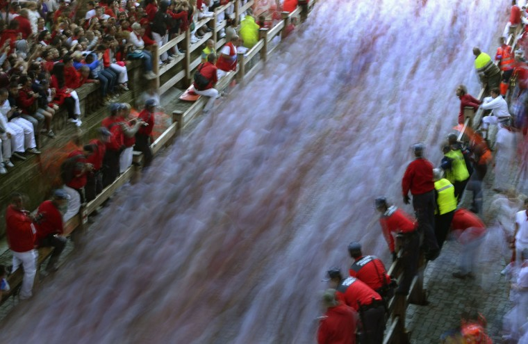Runners enter the bullring during the second running of the bulls of the San Fermin festival in Pamplona July 8, 2014. Two runners were hospitalized following a run that lasted two minutes and twenty seconds, according to local media. (REUTERS/Vincent West)
