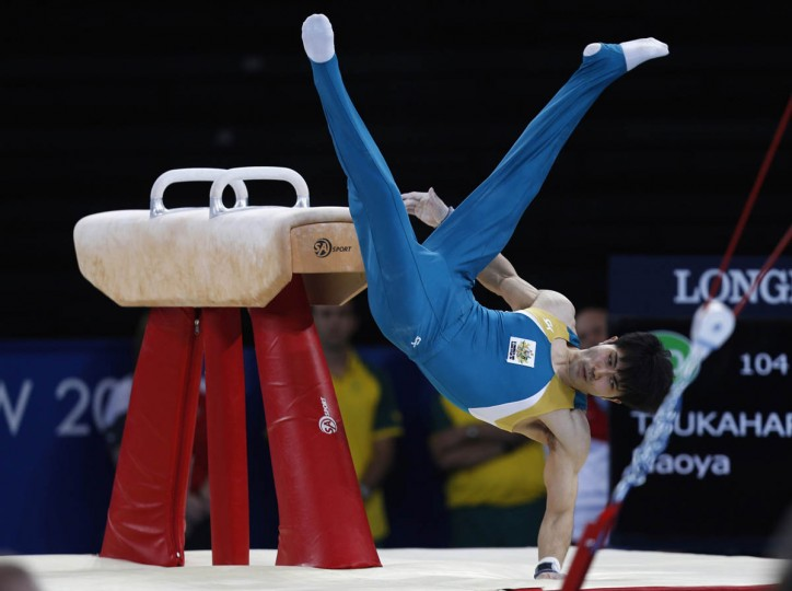Australia's Naoya Tsukahara falls off the pommel horse during his routine in the men's all-around gymnastics final at the 2014 Commonwealth Games in Glasgow, Scotland, July 30, 2014. (Russell Cheyne/Reuters photo)