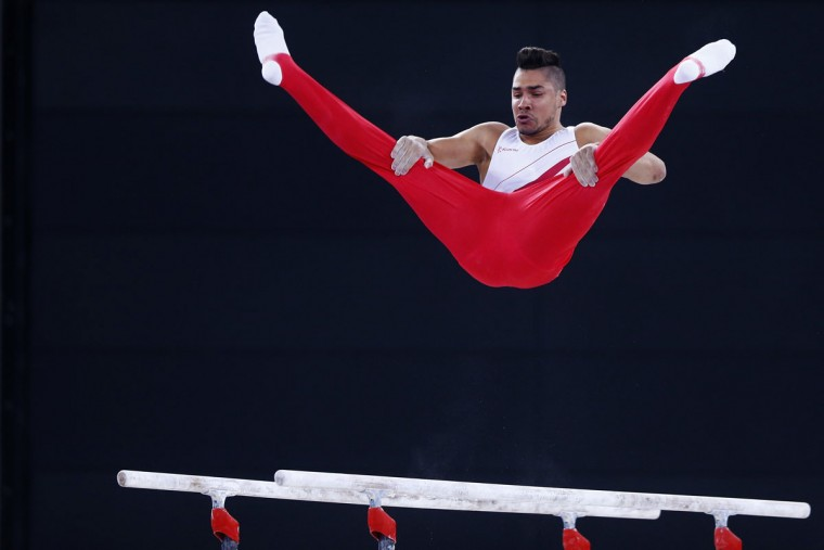 Louis Smith of England performs his routine on the parallel bars during the team apparatus final of the artistic gymnastics at the 2014 Commonwealth Games in Glasgow, Scotland, July 29, 2014. (REUTERS/Andrew Winning