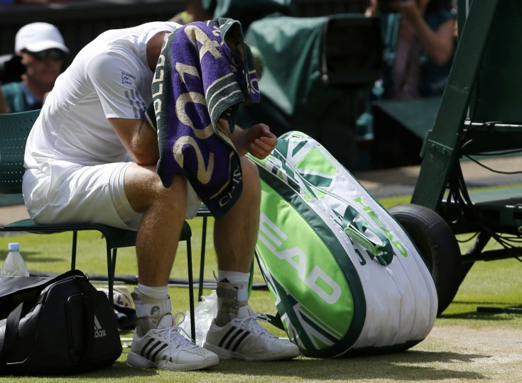 Andy Murray of Britain sits after being defeated by Grigor Dimitrov of Bulgaria in their men's singles quarter-final tennis match at the Wimbledon Tennis Championships, in London. (Suzanne Plunkett/Reuters)