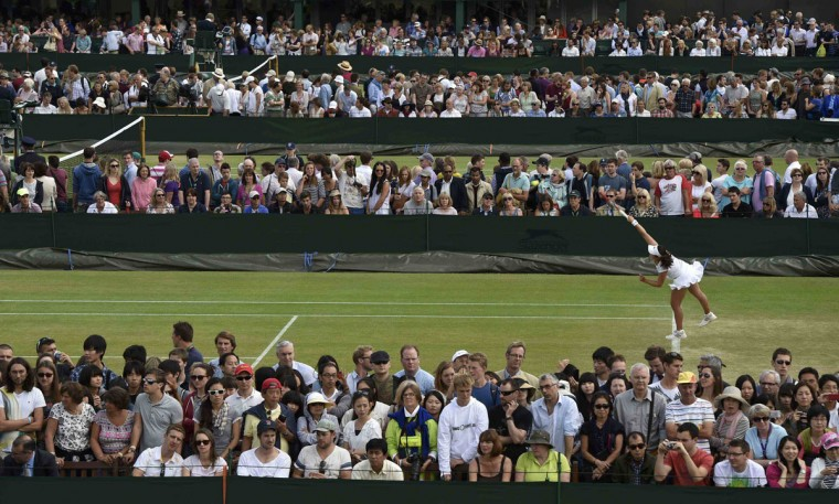Spectators watch play on outside courts at the Wimbledon Tennis Championships, in London June 30, 2014. (REUTERS/Toby Melville)