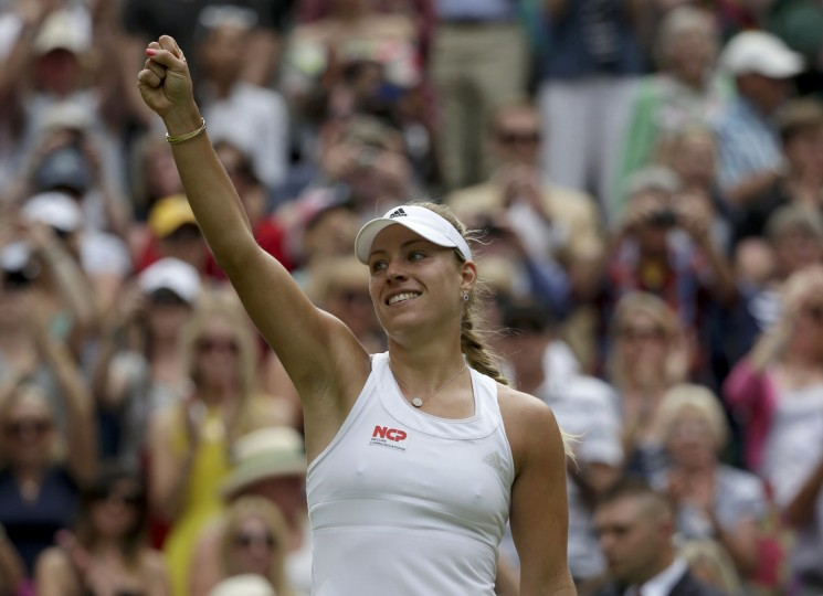 Angelique Kerber of Germany reacts after defeating Maria Sharapova of Russia in their women's singles tennis match at the Wimbledon Tennis Championships, in London July 1, 2014. (REUTERS/Max Rossi)