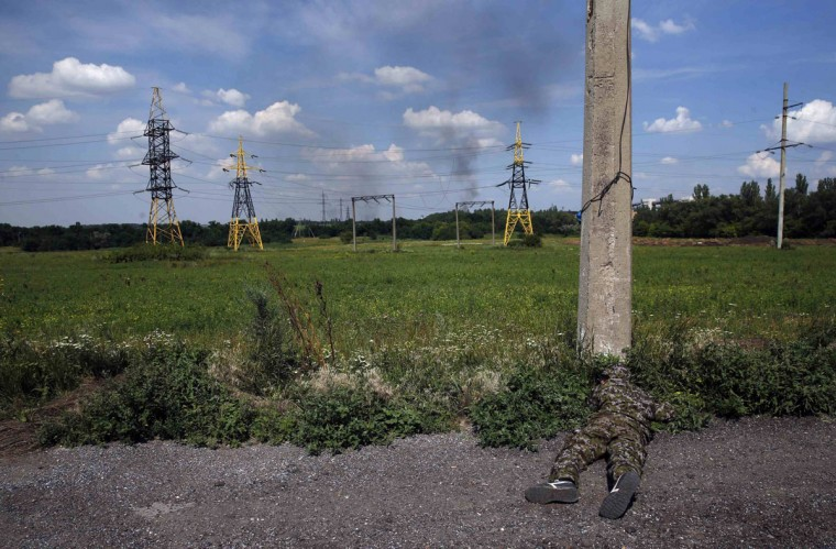 A pro-Russian separatist fighter from the so-called Battalion Vostok (East) looks out from a position at a check point on the outskirts of the eastern Ukrainian city of Donetsk, July 10, 2014. Ukrainian forces regained more ground but sustained further casualties on Thursday in clashes with separatists, while two Western allies urged Russia's Vladimir Putin to exert more pressure on the rebels to find a negotiated end to the conflict. REUTERS/Maxim Zmeyev