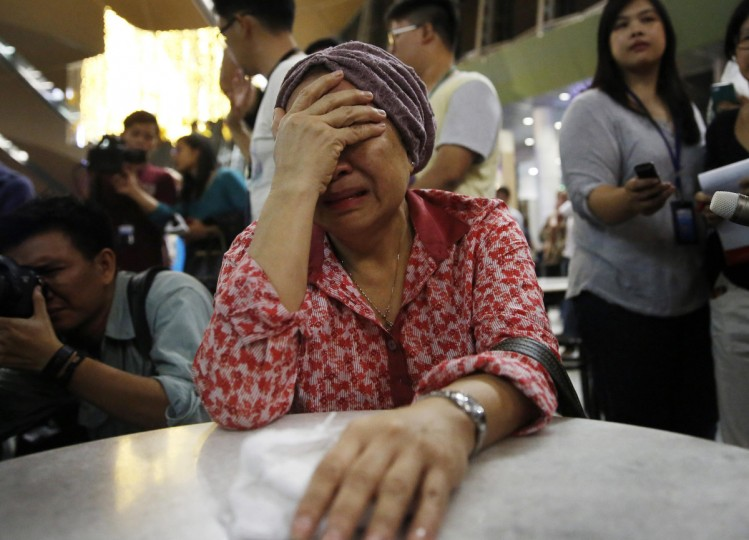 A woman, who said she believed her sister was on Malaysia Airlines flight MH17, cries as she waits for more information about the crashed plane at Kuala Lumpur International Airport in Sepang July 18, 2014. The Malaysia Airlines Boeing 777 was brought down over eastern Ukraine on Thursday, killing all 295 people aboard and sharply raising the stakes in a conflict between Kiev and pro-Moscow rebels in which Russia and the West back opposing sides. (Samsul Said/Reuters)