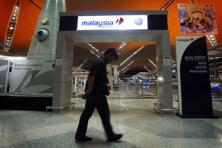 A man walks past the Malaysia Airlines check-in area at Kuala Lumpur International Airport in Sepang July 18, 2014. Malaysia Airlines flight MH-17 was shot down over eastern Ukraine by pro-Russian militants on Thursday, killing all 295 people aboard, a Ukrainian interior ministry official said. (Samsul Said/Reuters)