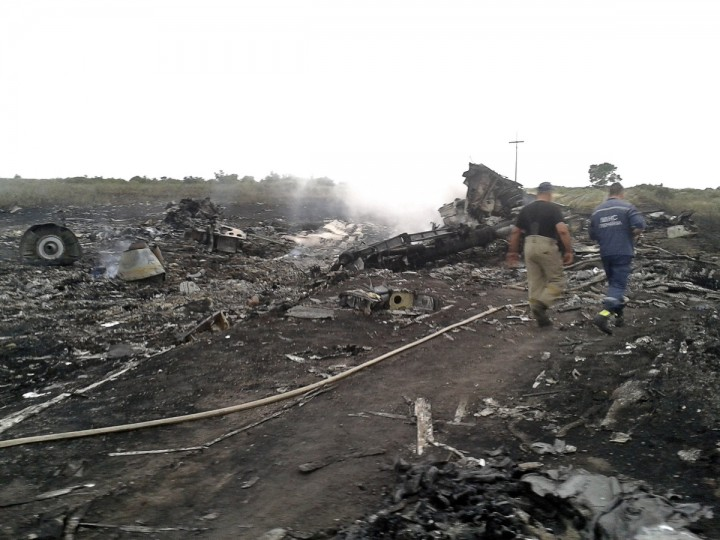 Emergencies Ministry members walk at the site of a Malaysia Airlines Boeing 777 plane crash in the settlement of Grabovo in the Donetsk region, July 17, 2014. The Malaysian airliner MH-17 was shot down over eastern Ukraine by pro-Russian militants on Thursday, killing all 295 people aboard, a Ukrainian interior ministry official said. Dozens of bodies were scattered around the smouldering wreckage of a passenger jet that crashed in a field in eastern Ukraine on Thursday, a Reuters reporter said. An emergency services rescue worker said at least 100 bodies had so far been found at the scene, near the village of Grabovo, and that debris from the wreckage was spread across an area up to about 15 km (nine miles) in diameter. (Maxim Zmeyev/Reuters)