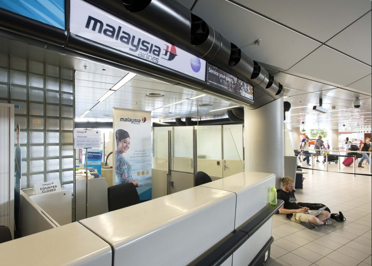 The desk of Malaysia Airways is seen at Schiphol Airport July 17, 2014. A Malaysia Airlines Boeing 777 plane was shot down over eastern Ukraine by pro-Russian militants on Thursday, killing all 295 people aboard, a Ukrainian interior ministry official said. (Paul Vreeker/United Photos)