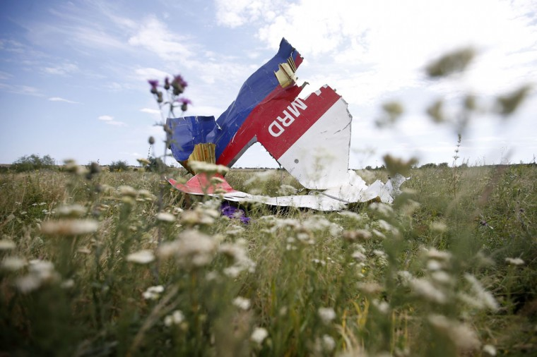 A part of the wreckage of Malaysia Airlines Flight MH17 is seen at its crash site, near the village of Hrabove, Donetsk region, July 20, 2014. U.S. Secretary of State John Kerry on Sunday laid out what he said was overwhelming evidence of Russian complicity in the downing of the Malaysian airliner in eastern Ukraine as he made the U.S. case against Moscow in the most emphatic and explicit terms yet. (Maxim Zmeyev/Reuters)