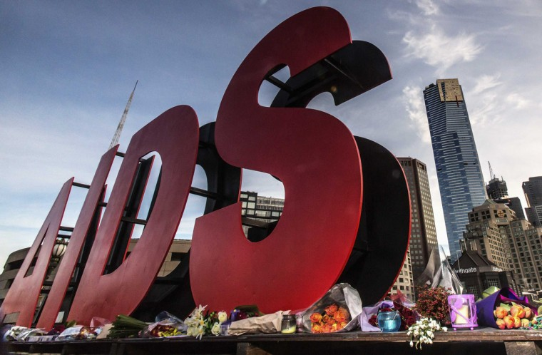 Flowers are laid as tributes to those killed in the Malaysia Airlines flight MH17, at the base of a large sign for the 20th International AIDS Conference in Melbourne July 20, 2014. At least six people aboard the flight, including Joep Lange, a leading light in the field of AIDS research, were heading to the AIDS 2014 Conference in Melbourne, according to the International AIDS Society (IAS) which organizes the event. The Boeing 777 plane was apparently brought down by a surface-to-air missile on Thursday in an area of eastern Ukraine. (Mark Dadswell/Reuters)
