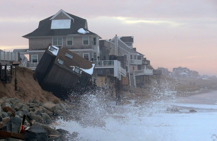 The rising tide comes up against a house on Plum Island that came off its foundation during an overnight winter storm on in Newbury, Massachusetts in this file photo from March 8, 2013. Coastal flooding along the densely populated Eastern Seaboard of the United States has surged in recent years, a Reuters analysis has found. REUTERS/Brian Snyder/Files
