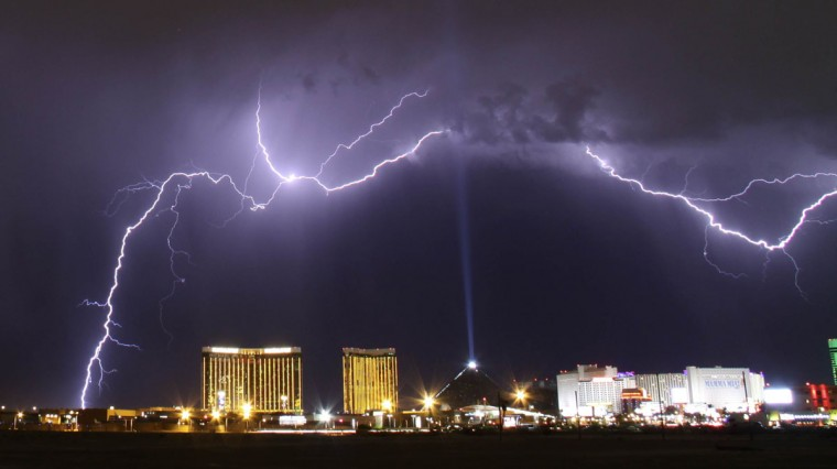 A monsoon lightning storm strikes over the Mandalay Bay Resorts and Casino and Luxor hotels in Las Vegas, Nevada late July 7, 2014. Monsoon storms are forecast for the the rest of the week in the Nevada and Arizona states. The Luxor Sky Beam can be seen shining into the sky from the top of the hotel's pyramid structure. (REUTERS/Gene Blevins)