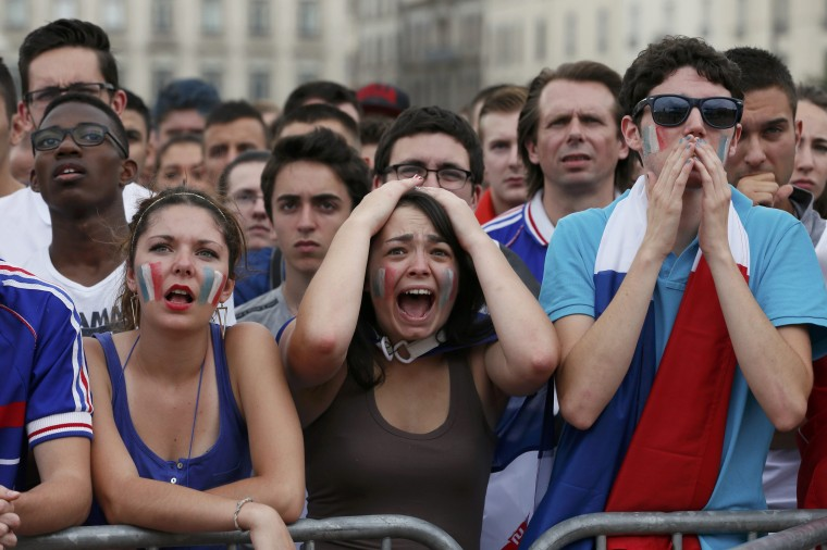 France fans react as they watch Friday's 1-0 quarterfinal loss to Germany. (Robert Pratta/Reuters)