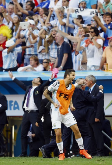 The Argentinian bench celebrates after their win against Belgium in the 2014 World Cup quarterfinals. At front is Argentina's Ricardo Alvarez. (REUTERS/Dominic Ebenbichler)