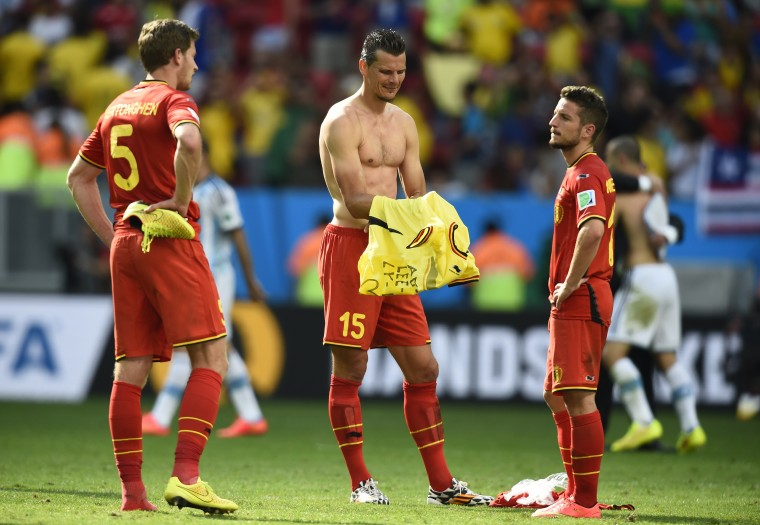 From left, Belgium's Jan Vertonghen, Daniel Van Buyten and Dries Mertens react to their team's loss against Argentina. (REUTERS/Dylan Martinez)