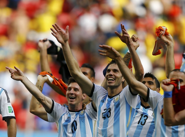 Argentina's Lionel Messi and teammates celebrate their win over Belgium. (REUTERS/Dominic Ebenbichler)