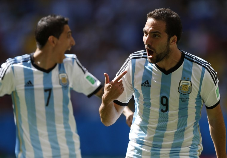 Argentina's Gonzalo Higuain (right) celebrates next to teammate Angel Di Maria after scoring a goal against Belgium. (REUTERS/Ueslei Marcelino)