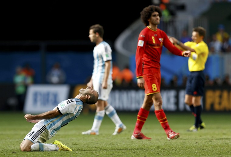 Argentina's Javier Mascherano (left) celebrates near Belgium's Marouane Fellaini (8) after their 2014 World Cup match. (REUTERS/Ueslei Marcelino)
