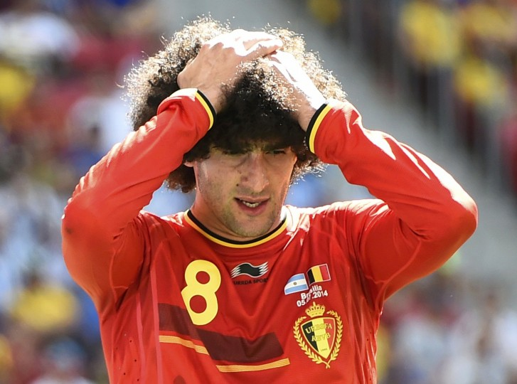 Belgium's Marouane Fellaini reacts after missing an opportunity to score a goal against Argentina. (REUTERS/Dylan Martinez)