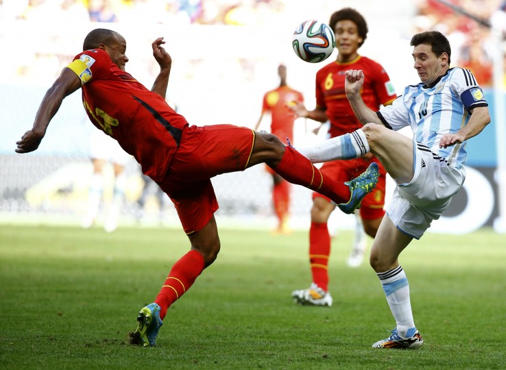 Belgium's Vincent Kompany fights for the ball with Argentina's Lionel Messi during their 2014 World Cup quarterfinal match. (REUTERS/Damir Sagolj)