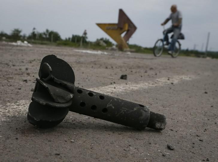 The remains of a 80mm mortar shell is seen in the eastern Ukrainian village of Semenovka on July 9, 2014. (REUTERS/Gleb Garanich)