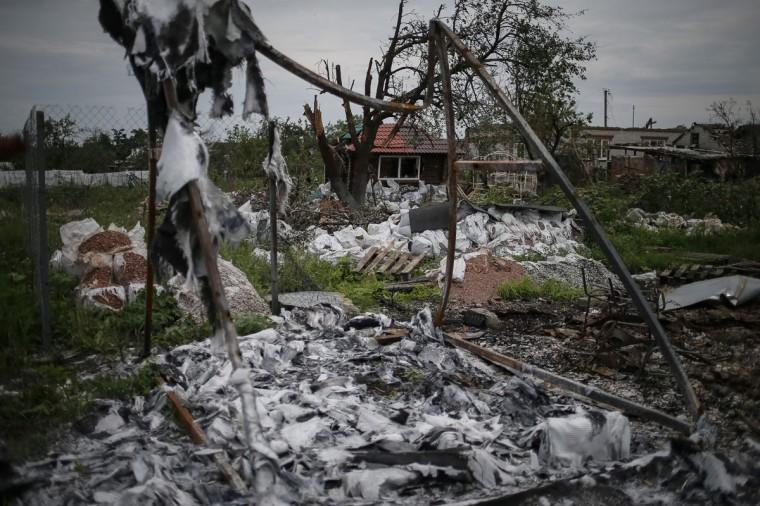 Buildings damaged by a recent shelling are seen in the eastern Ukrainian village of Semenovka on July 9, 2014. (REUTERS/Gleb Garanich)