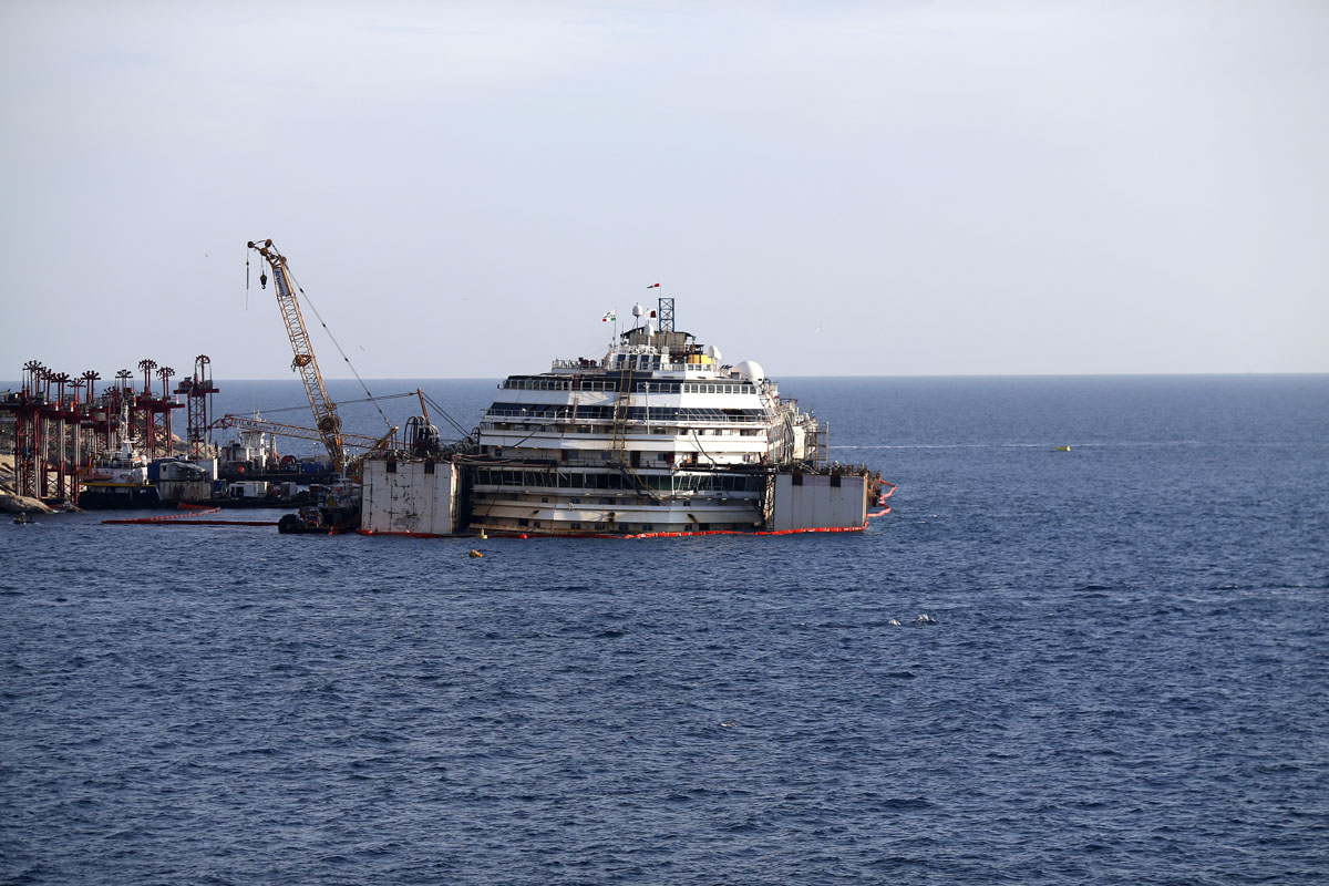costa concordia Rescuers were painstakingly checking thousands of cabins on the italian liner   striking photos as sinking cruise ship costa concordia lies in.