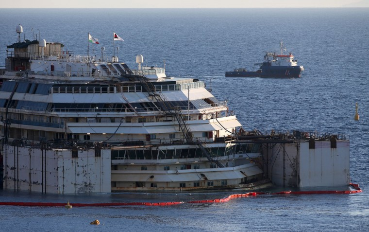 The cruise liner Costa Concordia is seen at Giglio harbor ahead of it being towed away July 15, 2014. (REUTERS/Alessandro Bianchi)