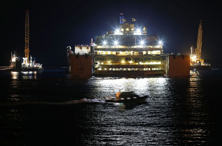 The Costa Concordia cruise liner is seen at Giglio harbor at Giglio Island, late July 17, 2014. (REUTERS/Alessandro Bianchi)