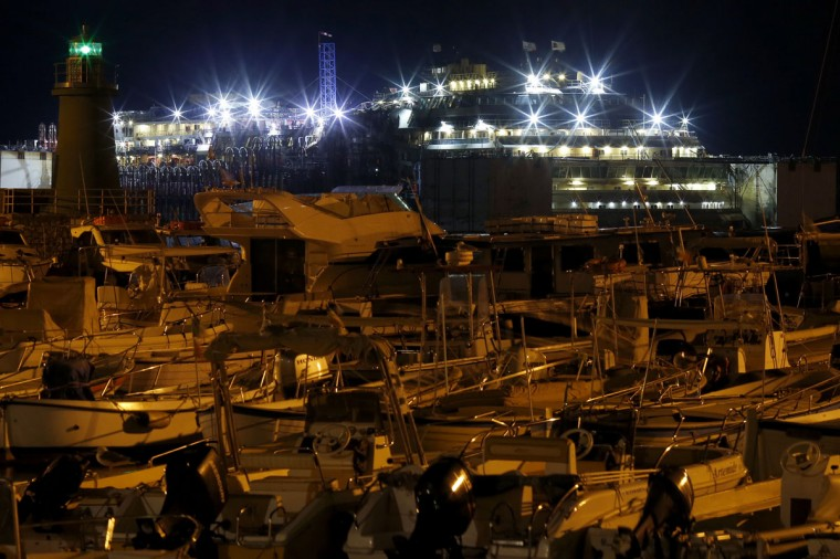 The Costa Concordia cruise liner is seen at Giglio harbor at Giglio Island, early July 18, 2014. (REUTERS/Alessandro Bianchi)