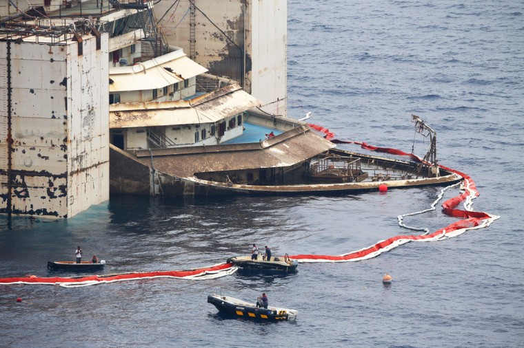 The bow of the Costa Concordia cruise liner is seen as it emerges during the refloating operation at Giglio harbor July 20, 2014. (REUTERS/Alessandro Bianchi)