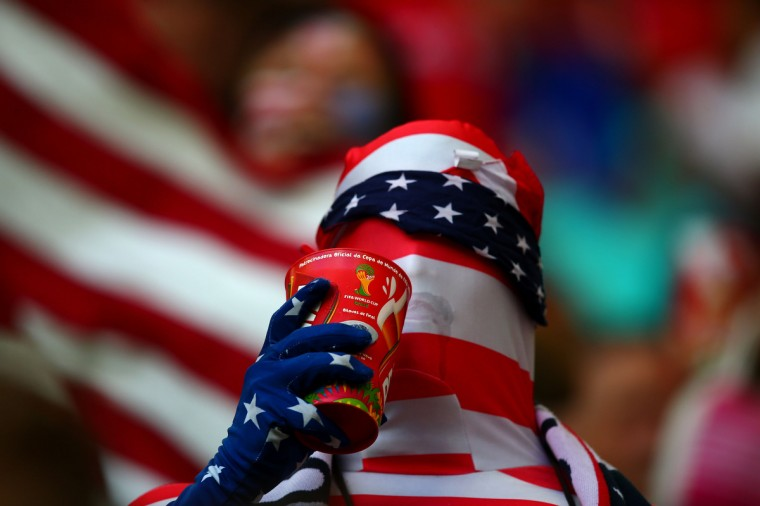 A USA fan drinks a beer in the grandstands prior to the match against Belgium during the round of sixteen match in the 2014 World Cup at Arena Fonte Nova. (Mark J. Rebilas/USA TODAY Sports)