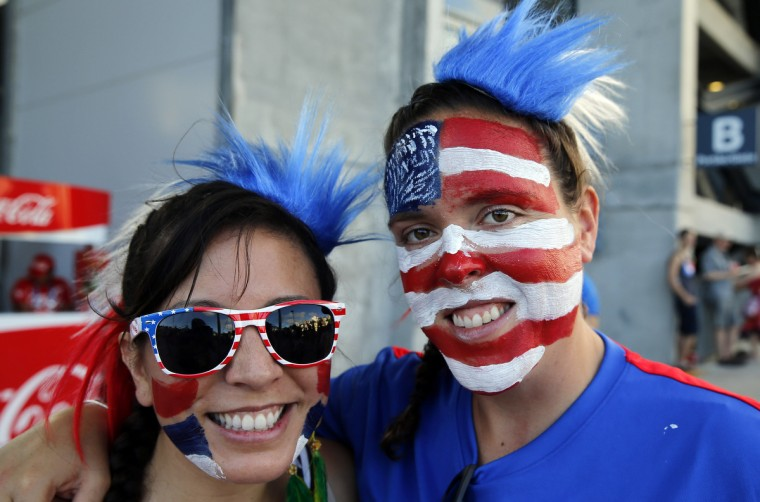 United States fans Christina Fujii (left) of Los Angeles and Chloe Bizer of Washington, D.C. inside the stadium before their round of sixteen match against Belgium in the 2014 World Cup at Arena Fonte Nova. (Winslow Townson/USA TODAY Sports)