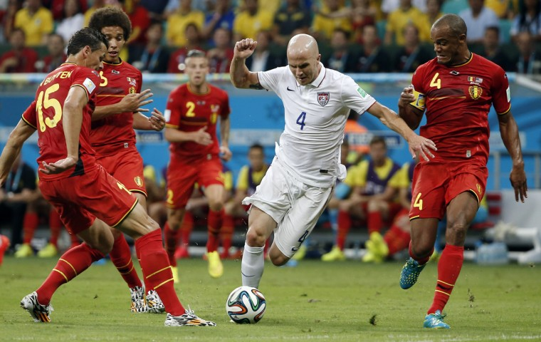 United States midfielder Michael Bradley (4) tries to get through Belgium defender Daniel van Buyten (15) and defender Vincent Kompany (4) during the first half of their round of sixteen match in the 2014 World Cup at Arena Fonte Nova. (Winslow Townson/USA TODAY Sports)