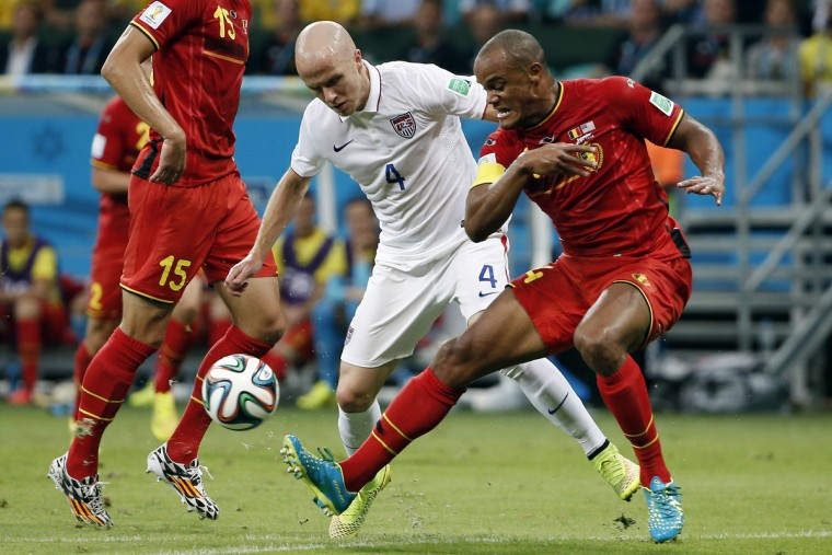Belgium defender Vincent Kompany (4) clears the ball away from United States midfielder Michael Bradley (4) during the first half of their round of sixteen match in the 2014 World Cup at Arena Fonte Nova. (Winslow Townson/USA TODAY Sports)
