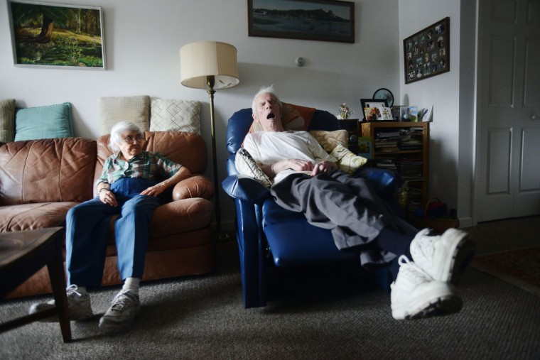 Eleanor Barnard looks at Roger Barnard as he sleeps on his chair mid-afternoon. Taking care of Roger exhausts Eleanor, leaving her to take daily naps. Rachel Woolf/Baltimore Sun