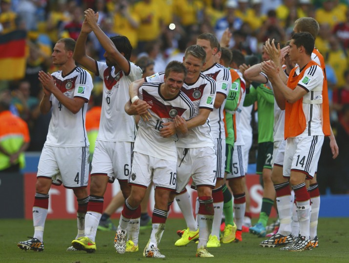 Germany celebrates its 1-0 win in the World Cup quarterfinals. The Germans advance to the semis, where they will face Brazil on Tuesday. (Eddie Keogh/Reuters)
