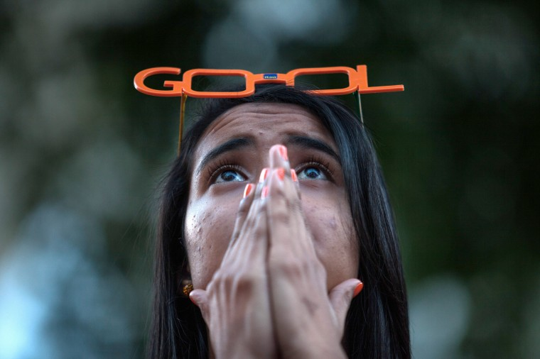 A Brazil fan watches the third place match between Brazil and the Netherlands at th