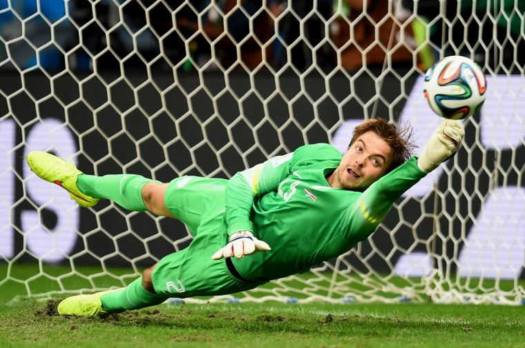 Tim Krul of the Netherlands saves a penalty kick by Michael Umana of Costa Rica (not pictured) to win in a shootout during the 2014 FIFA World Cup Brazil Quarter Final match between the Netherlands and Costa Rica at Arena Fonte Nova in Salvador, Brazil. (Jamie McDonald/Getty Images)