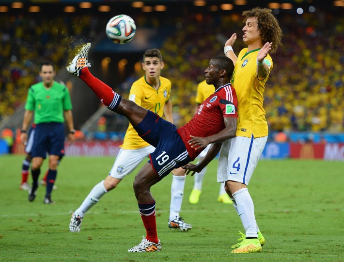 Adrian Ramos of Colombia controls the ball against David Luiz of Brazil during the 2014 FIFA World Cup Brazil Quarter Final match between Brazil and Colombia at Castelao in Fortaleza, Brazil. (Jamie McDonald/Getty Images)