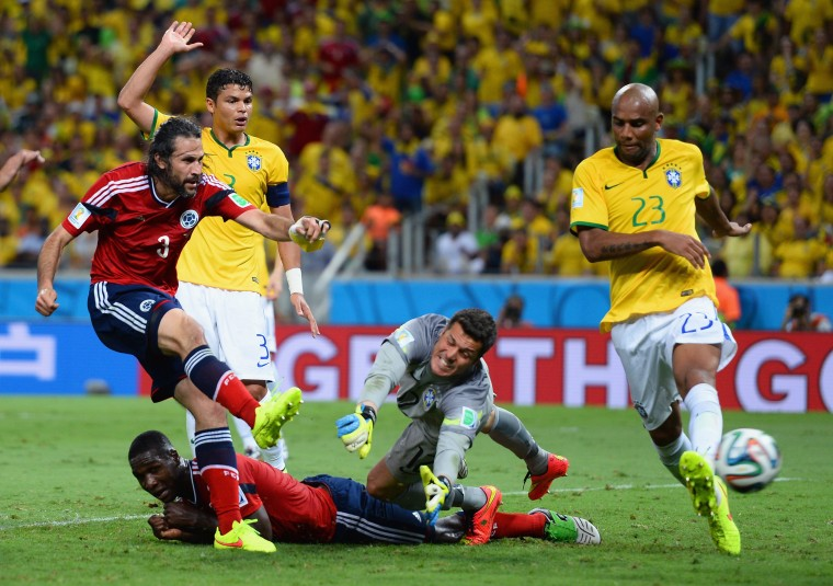 Mario Yepes of Colombia scores a goal past Julio Cesar of Brazil but it is disallowed during the 2014 FIFA World Cup Brazil Quarter Final match between Brazil and Colombia at Castelao in Fortaleza, Brazil. (Jamie McDonald/Getty Images)