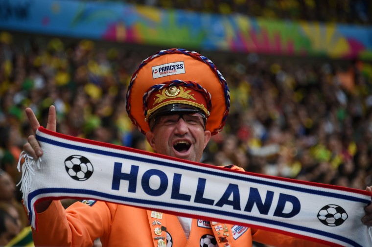 A Netherlands fan cheers for his team during the third place play-off football match between Brazil and Netherlands during the 2014 FIFA World Cup at the National Stadium in Brasilia. )Vanderlei Almeida/AFP-Getty Images)