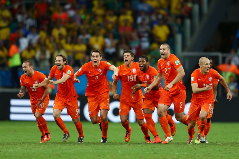 Wesley Sneijder, Daley Blind, Stefan de Vrij, Klaas-Jan Huntelaar, Jeremain Lens, Ron Vlaar and Arjen Robben of the Netherlands celebrate victory in a penalty shootout against Costa Rica during the 2014 FIFA World Cup Brazil Quarter Final match between the Netherlands and Costa Rica at Arena Fonte Nova in Salvador, Brazil. (Michael Steele/Getty Images)