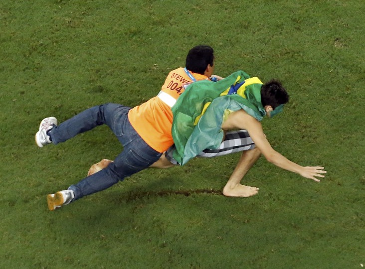 A steward tackles a fan on the pitch after their 2014 World Cup quarter-finals between Brazil and Colombia at the Castelao arena in Fortaleza.(Fabrizio Bensch/Pool/Reuters)