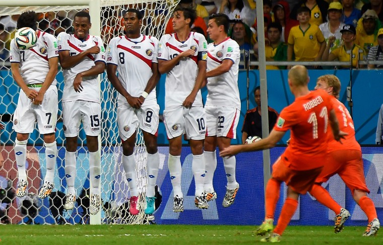 Netherlands' forward Arjen Robben (2md R) shoots a free kick towards Costa Rica's wall the quarter-final football match between the Netherlands and Costa Rica at the Fonte Nova Arena in Salvador during the 2014 FIFA World Cup. (Odd Anderso/AFP-Getty Images)