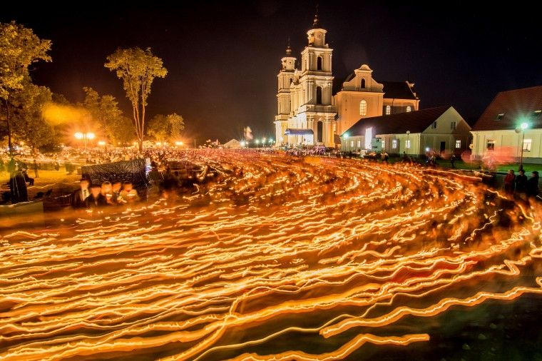 Belarus' Catholics attend the annual celebration of Icon of the Mother of God in Budslav some 150 km north of Minsk early. Thousands of Catholics come to Budslav as pilgrims to participate in prayer, confession and take part in a procession with candles, dedicated to the celebration of the anniversary Budslav Mother of God. (Sergey Balay/AFP-Getty Images)