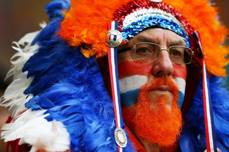 A Netherlands fan enjoys the atmosphere prior to the 2014 FIFA World Cup Brazil Quarter Final match between the Netherlands and Costa Rica at Arena Fonte Nova in Salvador, Brazil. (Steele/Getty Images)