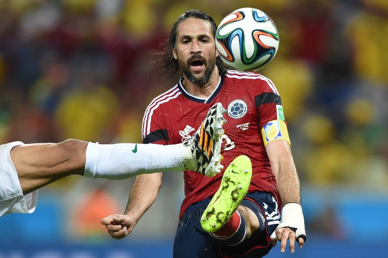 Colombia's defender and captain Mario Alberto Yepes (R) kicks the ball during the quarter-final football match between Brazil and Colombia at the Castelao Stadium in Fortaleza during the 2014 FIFA World Cup. Eitan Abramovich/AFP-Getty Images)